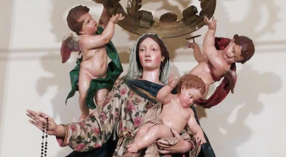 Il volto della Madonna e il Bambino