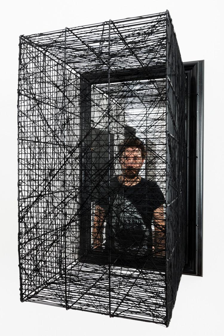Andrea Bianconi, In Between (2014; gabbia e specchio/cage and mirror, 69 x 43 x 45 cm; courtesy Barbara Davis Gallery, Houston TX, USA) )