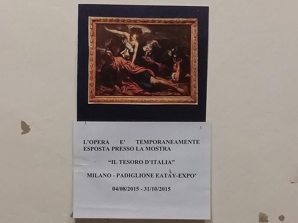 Un cartello indica l'assenza del San Pietro in carcere di Giovanni Francesco Guerrieri dalla sua parete alla Galleria Nazionale delle Marche di Urbino, nel 2015: era stata prestata per la mostra di Sgarbi e Eataly all'Expo di Milano