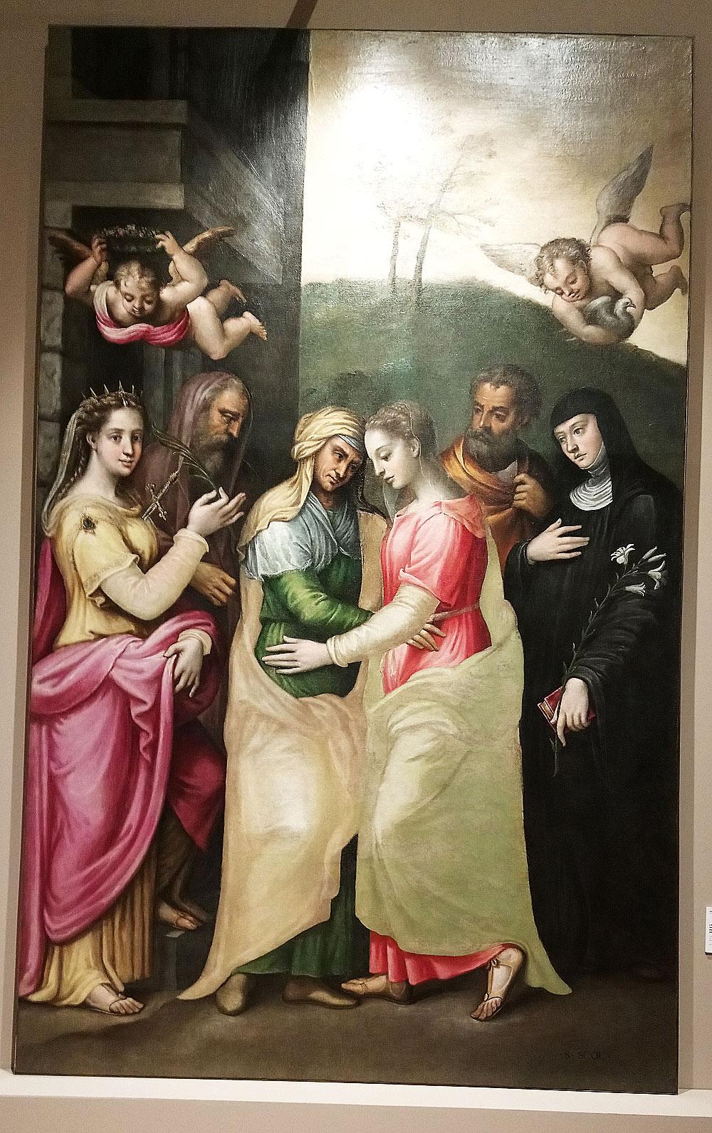 Fermo Ghisoni, L'incontro della Vergine con santa Elisabetta alla presenza dei santi Giustina, Gioacchino, Giuseppe e Scolastica (1542 circa; olio su tela, 288 x 176 cm; San Benedetto Po, Basilica)
